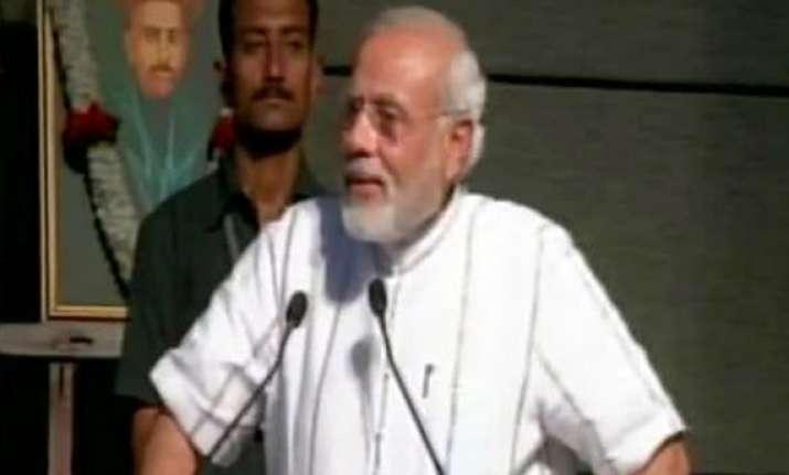 modi s burqa remark congress attacks modi over his veil of