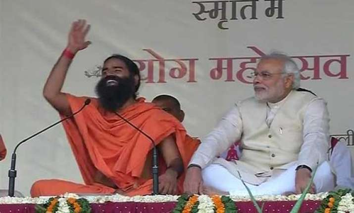 modi says govt harassing ramdev for raising black money