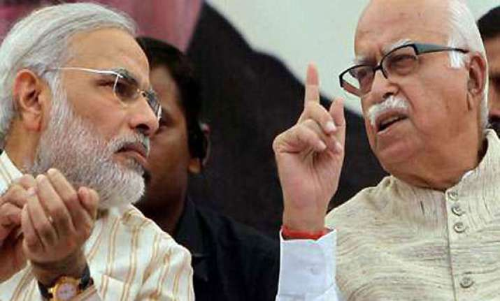 modi showers praise on advani asks bjp workers to ensure