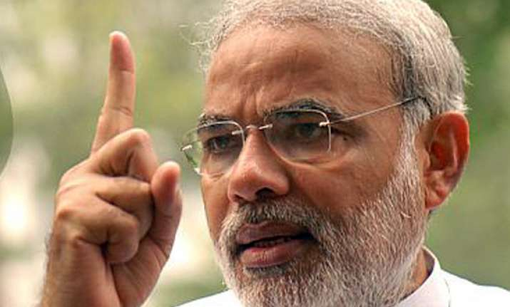 modi to decide on indicted gujarat minister bjp