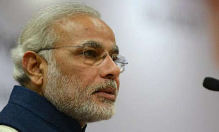 modi welcomes advani s decision to stay on