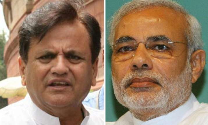 modi trying to play communal card by naming ahmed patel