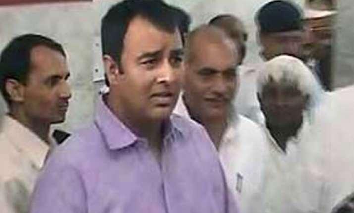 muzaffarnagar riots bjp legislator sangeet som surrenders