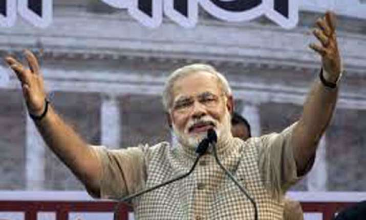 narendra modi once sold tea now will govern india