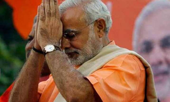 narendra modi pays homage to rajiv gandhi on twitter