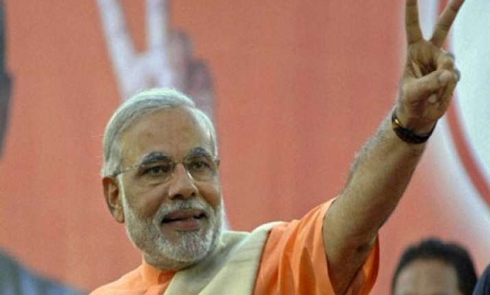 narendra modi to head both government and alliance sources
