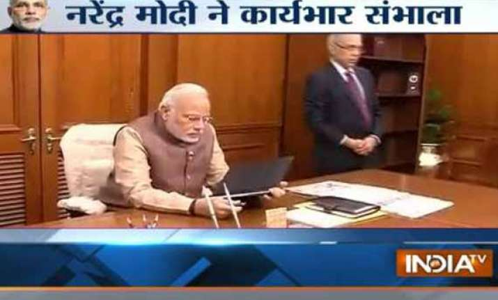 narendra modi takes charge as prime minister of india