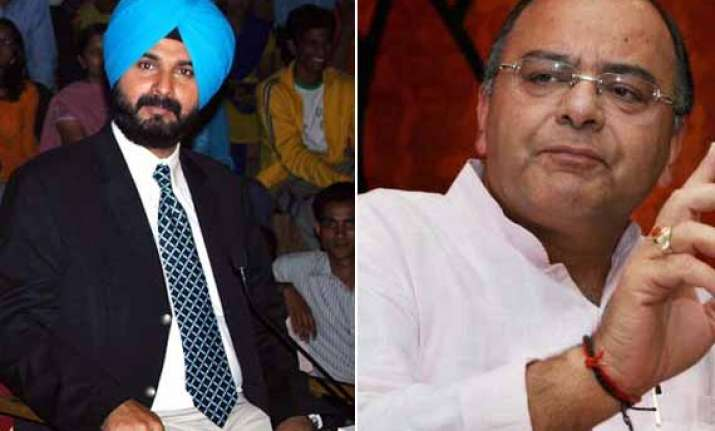 navjot sidhu insists on contesting from amritsar party