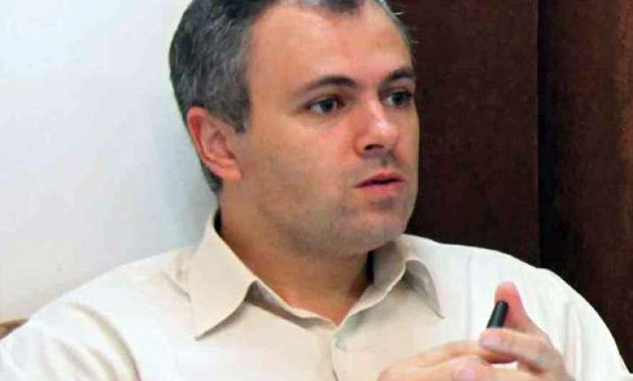 omar defends curfew in valley