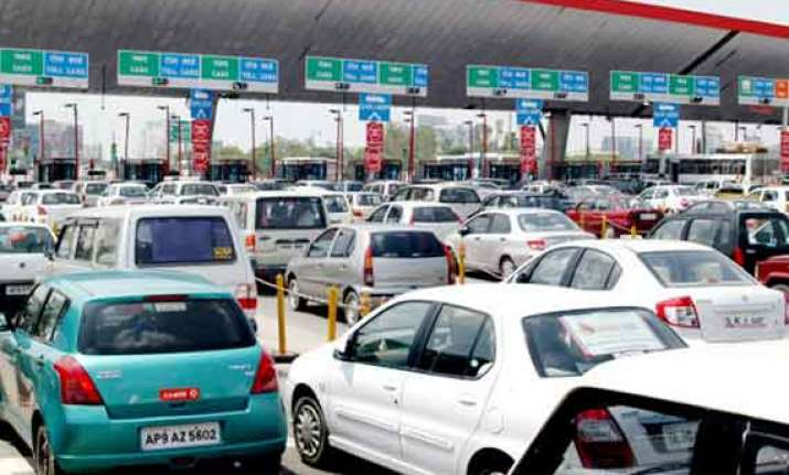 opposition attacks bjp on toll tax hike