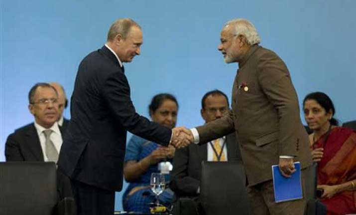 pm modi meets putin favours broadening of strategic