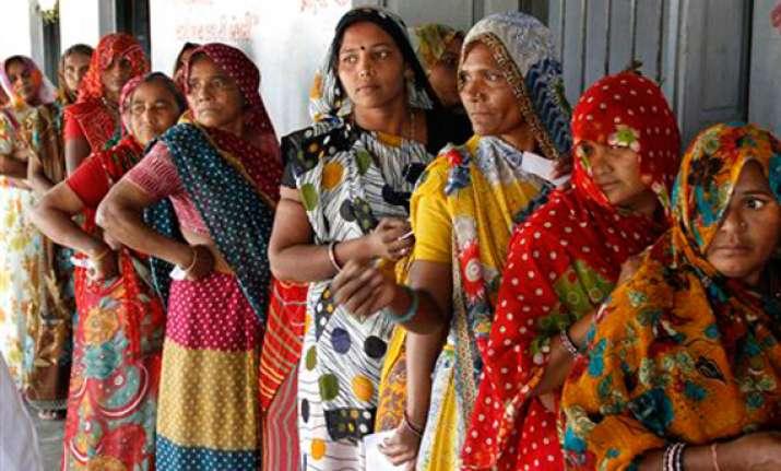 gujarat polls record 67 per cent turnout in modi versus