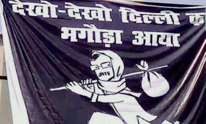 posters call kejriwal a bhagoda as he arrives in varanasi