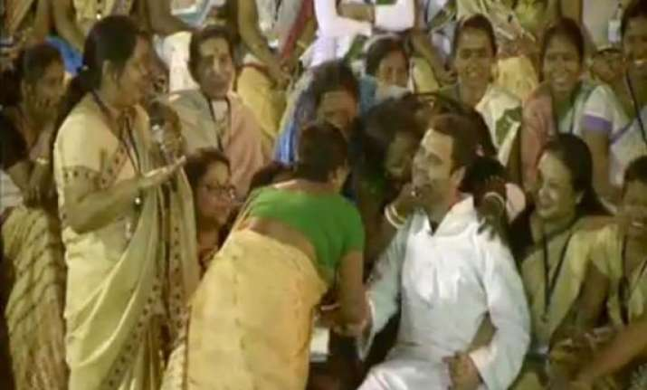 rahul bombarded with kisses in assam