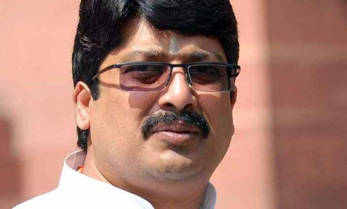 raja bhaiyya gets clean chit in dsp murder case