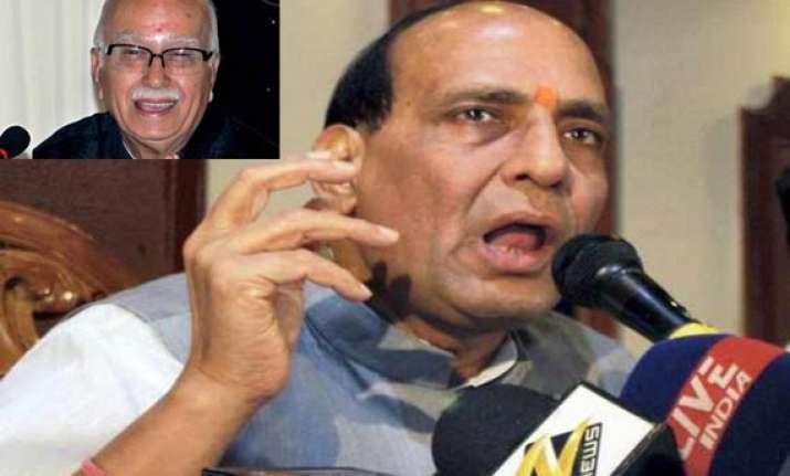 rajnath rejects resignation senior leaders flock to advani