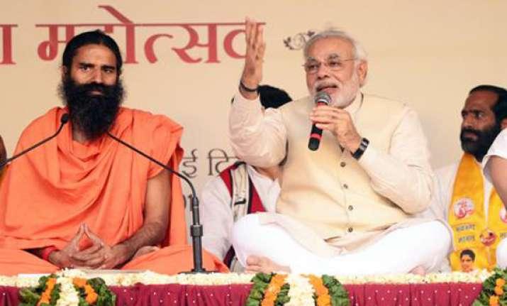 ramdev supporters root for modi at yoga guru s show