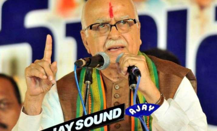 scams tarnishing india s image abroad advani