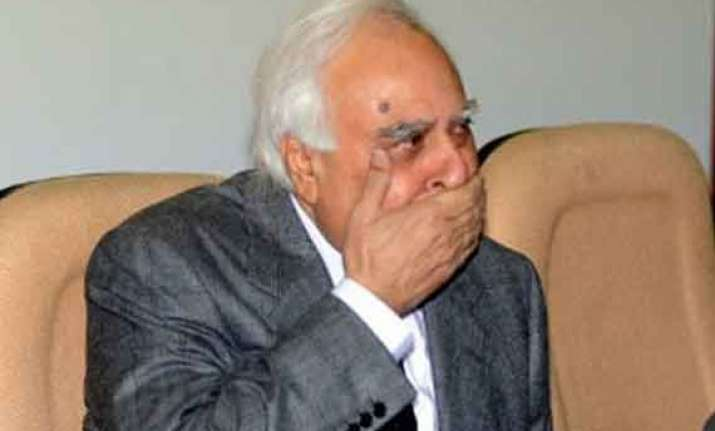 sibal opens his twitter account blunders by following anti