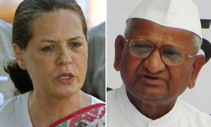 sonia gandhi defends pm describes team anna s charges as