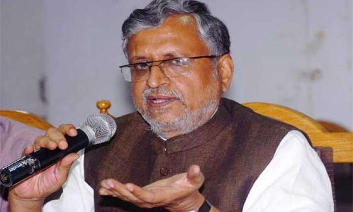 sushil plays up divergent views of manjhi nitish