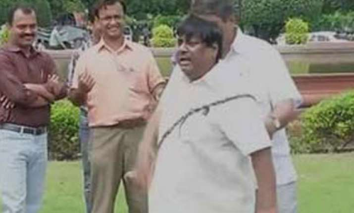 tdp mp lashes himself outside parliament