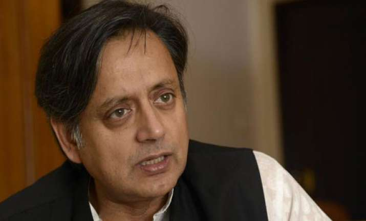 tharoor jibe at modi let s hope sharif is served biryani