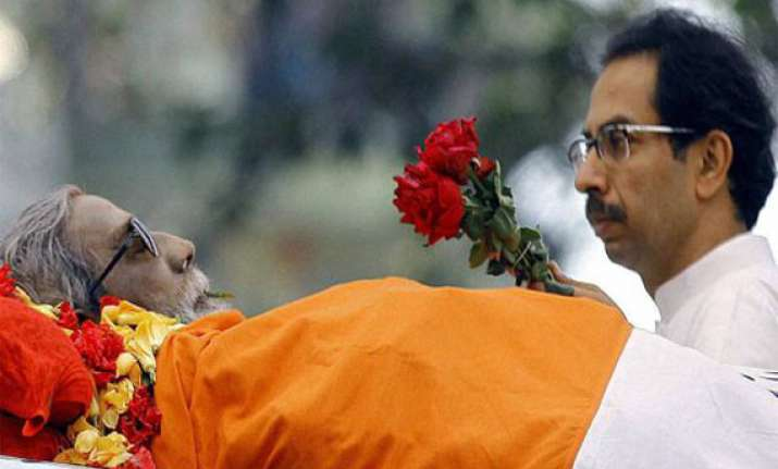 uddhav collects father s ashes