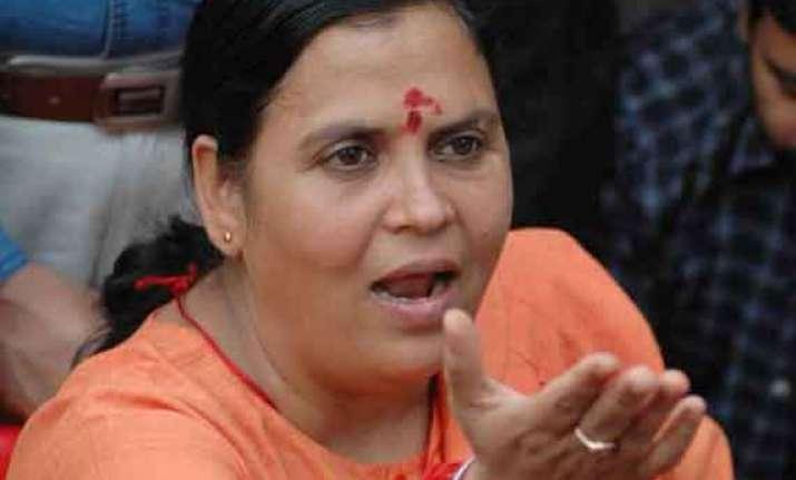 uma bharti cautions officials against maoist elements in