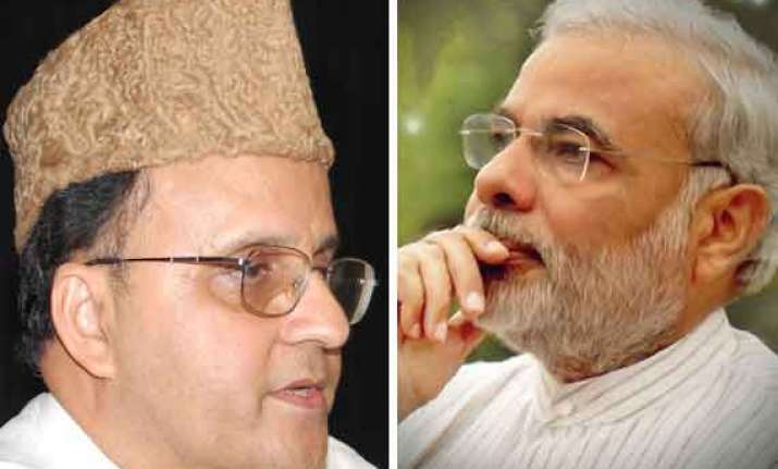 modi watches in silence as his critic mahmood gives