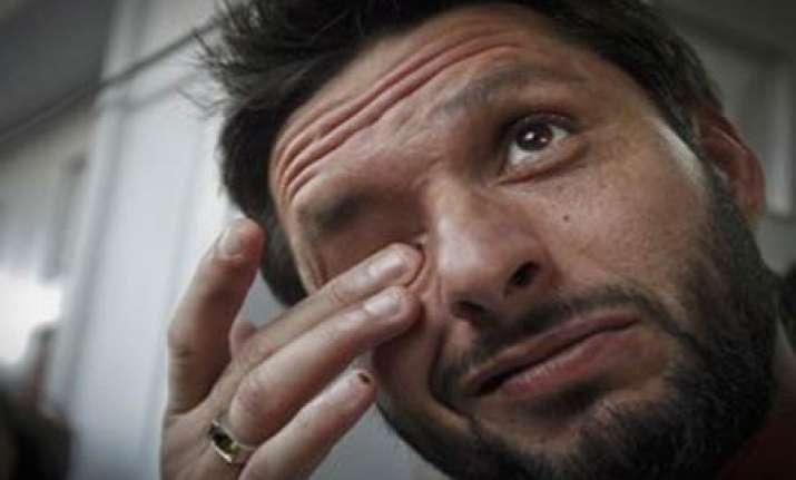 afridi quits international cricket slams pcb