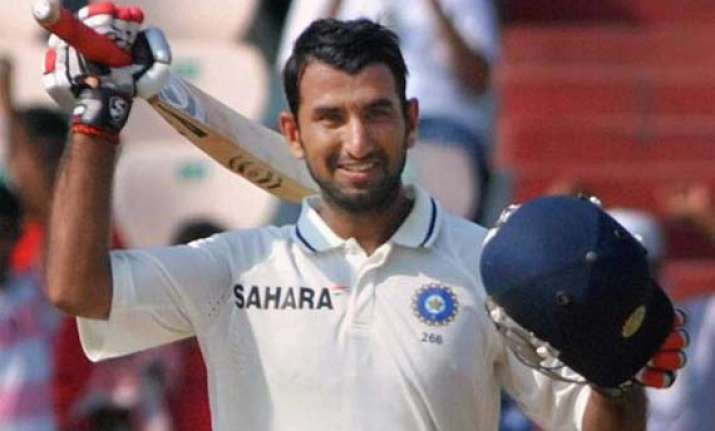 pujara hits his maiden double ton yuvraj out for 74