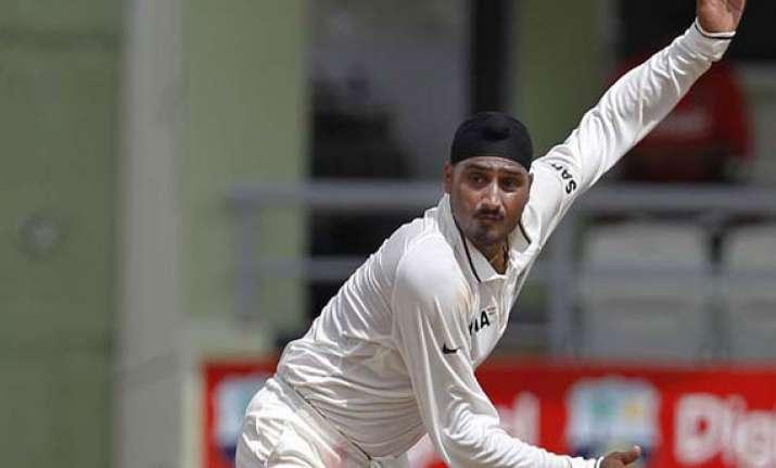 back in test squad harbhajan leads punjab to ranji win