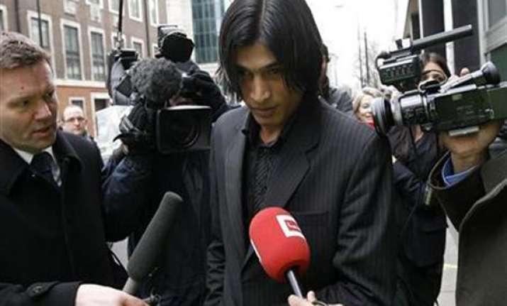 banned amir returns home