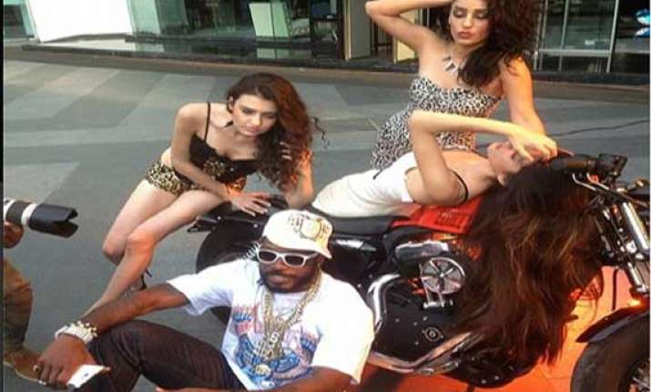 chris gayle might be missing the cricket but he is having