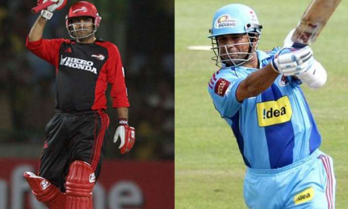 clash of titans as sachin s mi meets viru s dd
