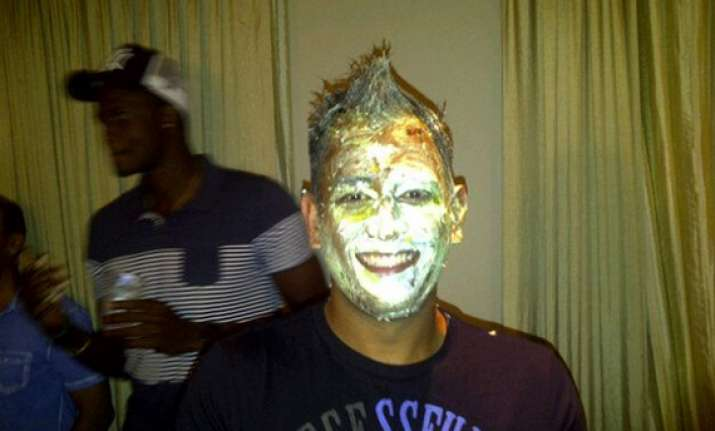dhoni posts pic of birthday cake all over his face