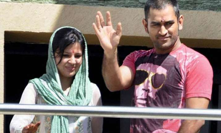 dhoni arrives home to a grand welcome