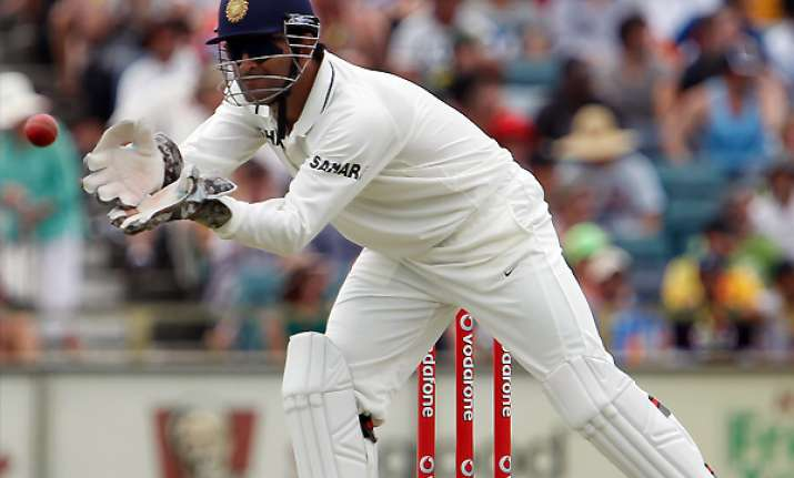 dhoni handed one match ban for slow over rate