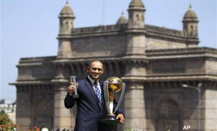 dhoni sports a bald look after wc triumph