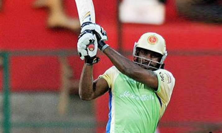 gayle blitzkrieg helps rcb beat kkr takes them to play offs