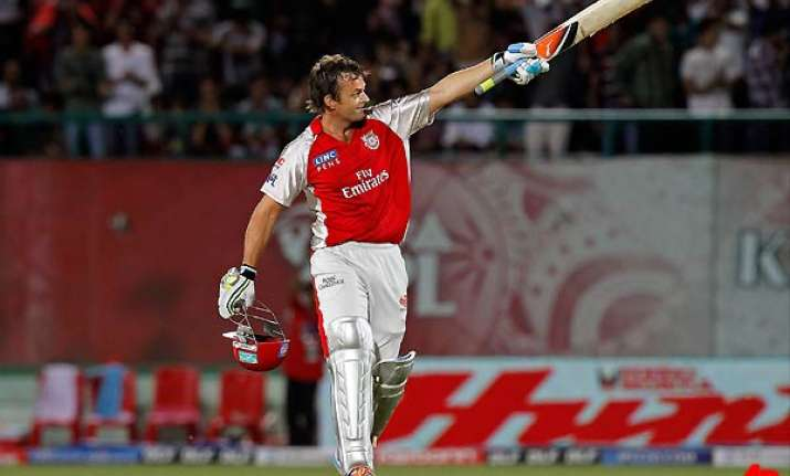 gilchrist smacks century in punjab s big win over rcb