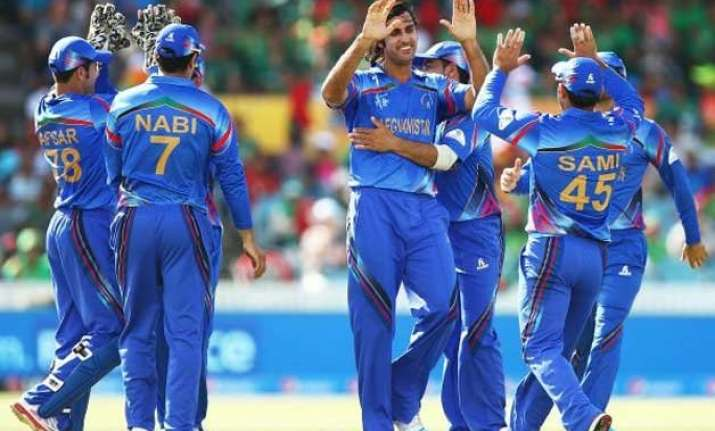 afghanistan beat scotland by 14 runs in world t20 qualifier