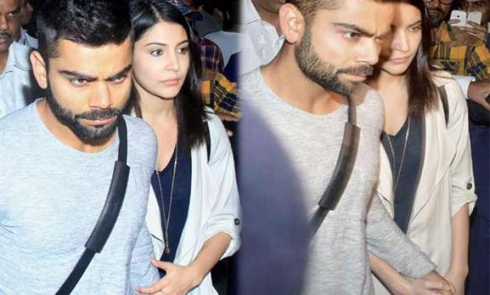 virat s reply to cyber bullies holds anushka s hand as the
