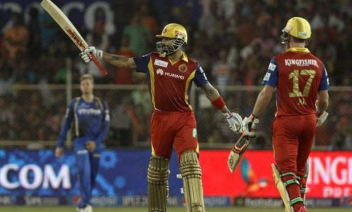 ipl 8 kohli starc guide rcb to nine wicket win over rr