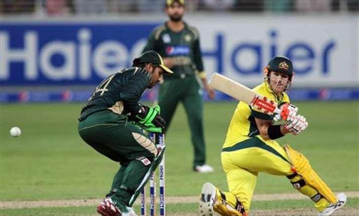 pak vs aus smith warner hit 50s to guide australia to 231 9