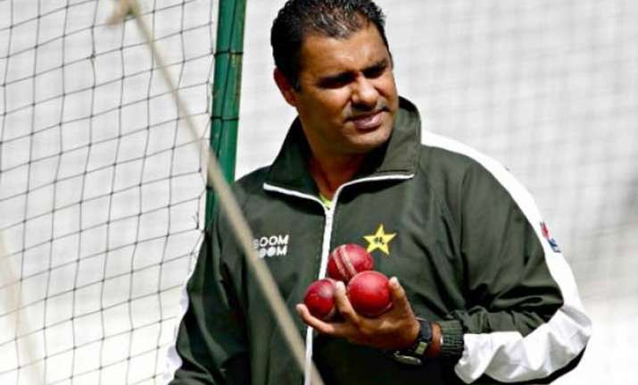 world cup waqar happy with pakistan not among favorites