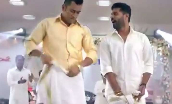 watch dhoni shakes a leg with prabhu deva in a dhoti