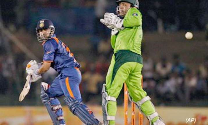 india beat pakistan by three wickets in cliffhanger