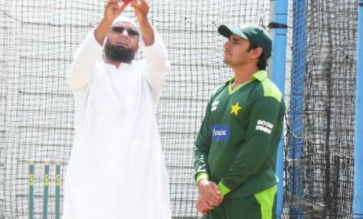 ajmal bowls with revamped action under saqlain s supervision